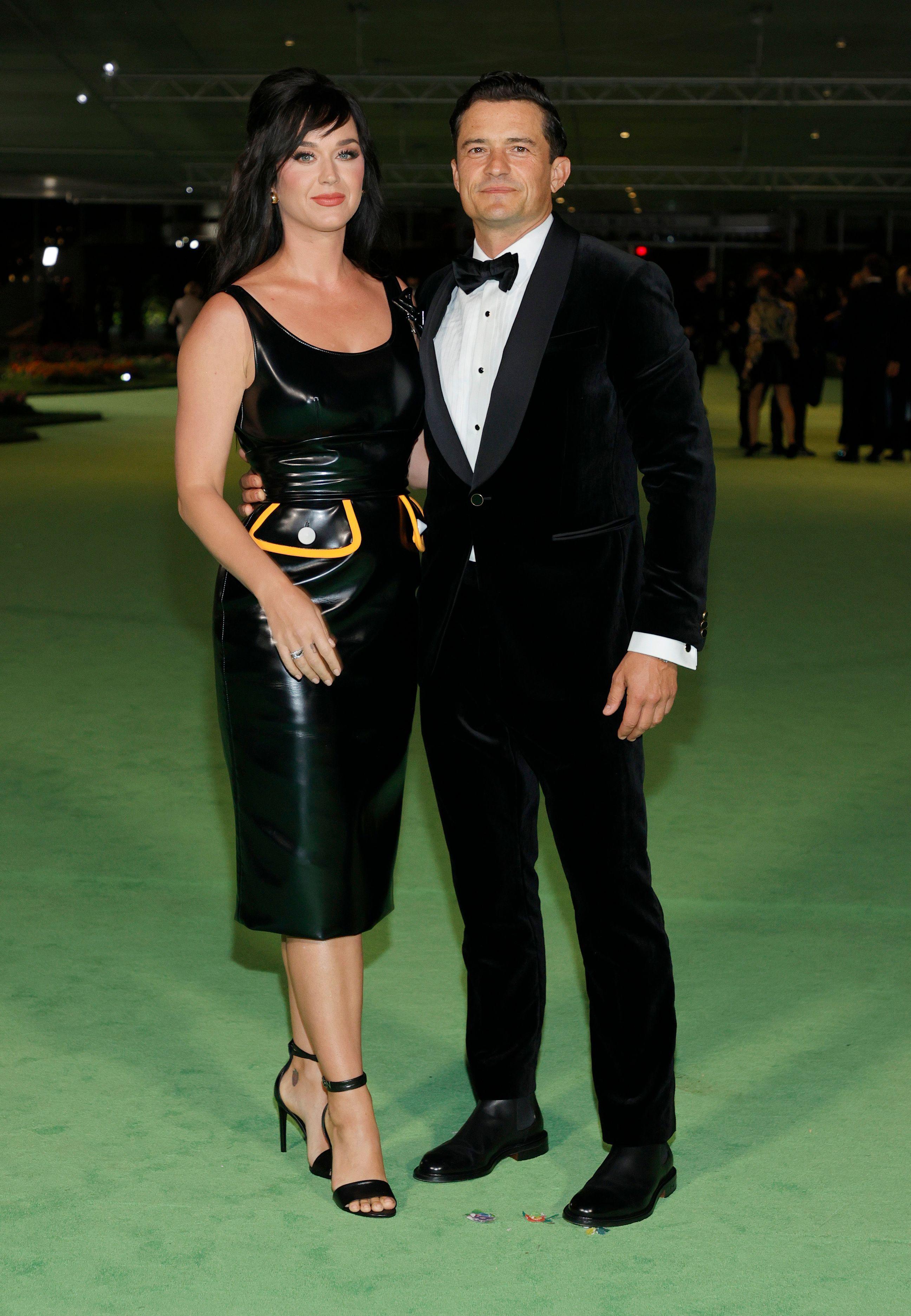 Кэти Перри в Louis Vuitton и Орландо Блум.